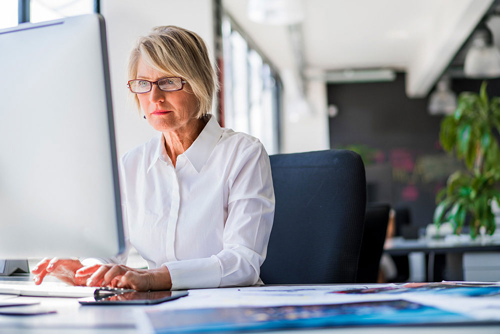Business Online Banking Woman at Computer